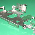 Formed chassis with PEM pressed inserts